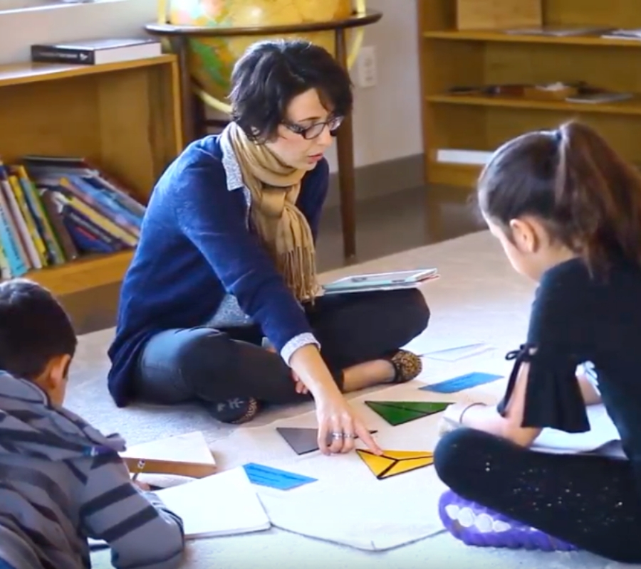 A Montessori Elementary School guide leading a lesson