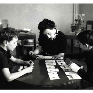 Maria Montessori working with a child