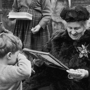 Maria Montessori working with a children