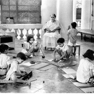 Maria Montessori working with children